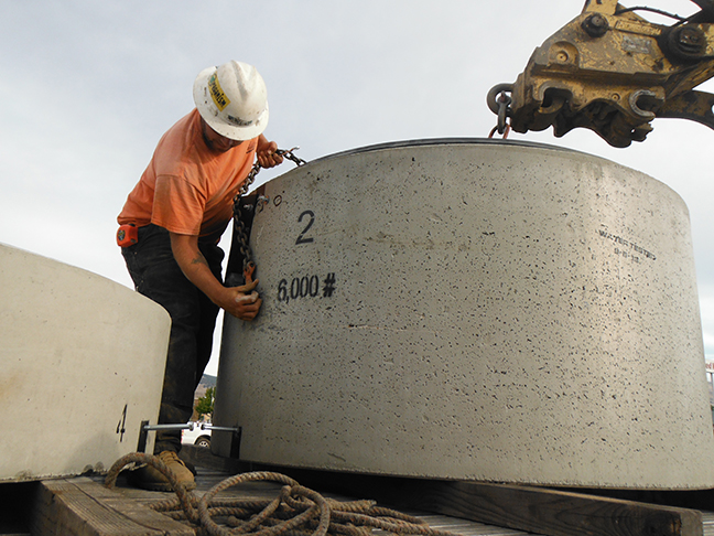 Precast Segment of Wet Well Being Prepared to Lift Up