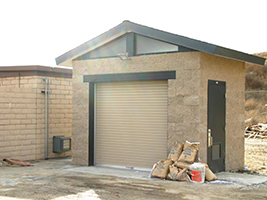 Equipment and Control Building with Roll Up Door