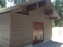 Brown Control Building with Double Man Door