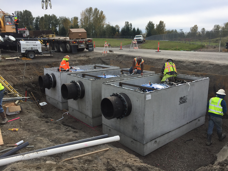 Three Prefabricated Valve Aseemblies Being Placed